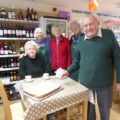 Volunteers run the community shop, which is owned and managed by over half of villagers.